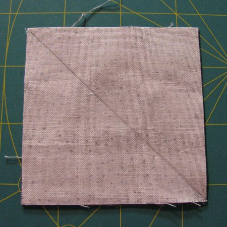 Draw a line from corner to corner on the lighter fabric.